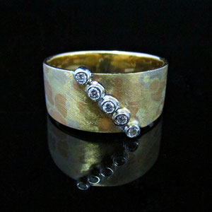 DF 38 - 14K mokume ring.  Yellow, white, and rose gold are combined.  With 5 bezel set diamonds.
