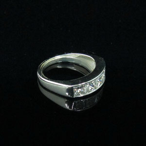 B 13 - Platinum princess cut diamond channel band.