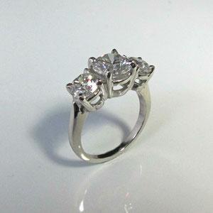 DF 14 - 14K white gold three stone diamond ring.