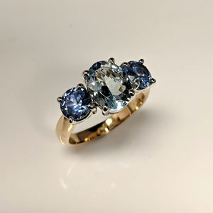 CS 48 - 14K two tone 3 stone ring with center aquamarine, and two Montana sapphires.