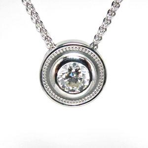 P 61 - 14K white gold bezel set diamond pendant.