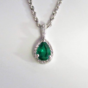 JS 15.2 - 14K white gold pendant with pear shaped emerald surrounded by diamonds.