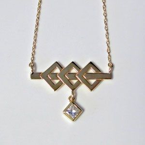 P 71 - 14K yellow gold necklace with geometric design and a bezel set square diamond.
