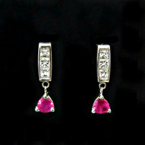 E 93 - 14K white gold earrings with square diamonds and trillion ruby dangles.