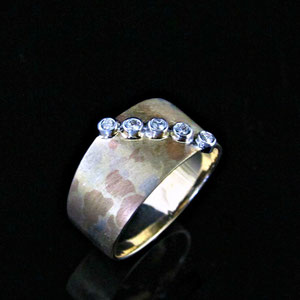 B 25 - 14K mokume ring.  Yellow, white, and rose gold are combined.  With 5 bezel set diamonds.