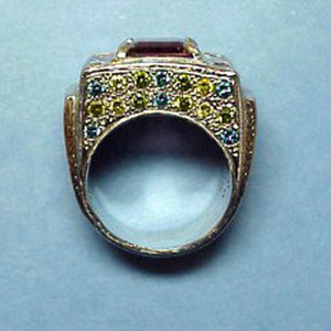 G 5 - Side view. Platinum custom designed ring with center pink tourmaline; blue, green, and white diamonds.