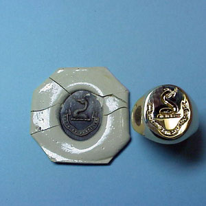 G 9 - 14K yellow gold hand engraved crest ring with wax relief.