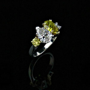 DF 39 - 14K white gold ring with pear shaped and round yellow and white diamonds.