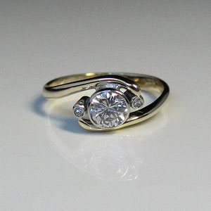 DF 11 - 14K two toned gold gold bypass ring with bezel set diamonds.