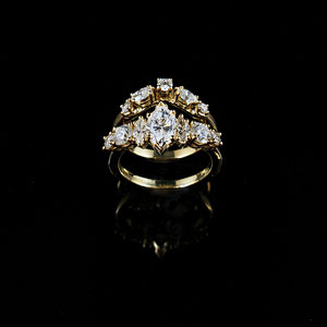 WF 43 - 14K yellow gold custom wedding set with center marquise diamond, and round and marquise side diamonds.