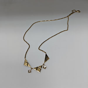 P 108 - 14K yellow gold necklace with triangle shapes and diamond accents.