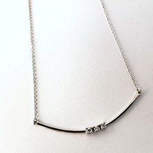 P 84 - 14K white gold 'smile' necklace with 3 diamonds.