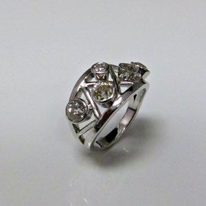 DF 42 - 14K white gold woven design band with bezel set diamonds.