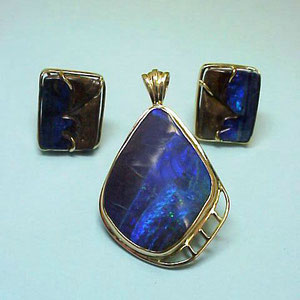JS 4 - 14K yellow gold boulder opal earrings and pendant.