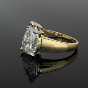 WF 7 - 14K two toned gold ring with pear shaped diamond.