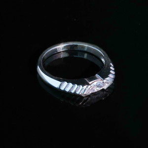 B 8 - 14K white gold band with marquise shaped diamond.