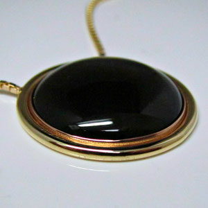 P 33  - 14K yellow and rose pendant with black onyx.