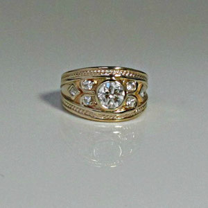 DF 6 - 14K yellow gold band with bezel set diamonds and twist wire embelishment.