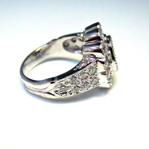 CS 35 - side view.  14K white gold ring with pave' set diamonds and bezel set emerald.