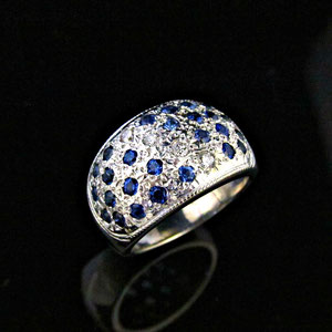 CS 18 - 14K white gold ring featues bead set diamonds and sapphires.