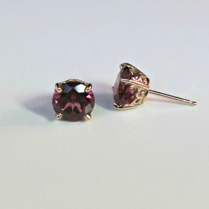 E 17 - 14K rose gold earrings with rhodolite garnet.