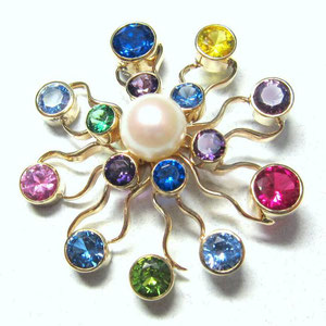 PB 4 - 14K yellow gold starburst brooch with center pearl,  and multi colored gemstones.