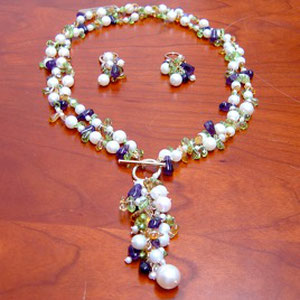 JS 8 - 14K yellow gold necklace and earring suite with amethyst, peridot, citrine and pearl beads.  The necklace features a removable tassle.