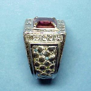 G 5 - Platinum custom designed ring with center pink tourmaline; blue, green, and white diamonds.