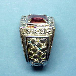 G 5 - Platinum custom designed ring with center pink tourmaline; blue, green, and white diamonds.