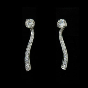 E 6 - 14K white gold dangle earrings with diamonds.