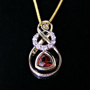 P 97 - 14K two tones pendant with garnet and diamonds.