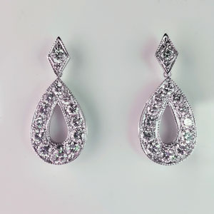 E 96 - 14K white gold earrings with diamonds.