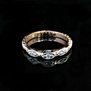 B 19 - 14K rose and white gold engagement ring with diamonds.
