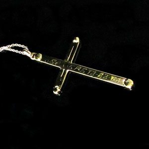 P 94 - 14K yellow gold cross pendant made from customer's wedding bands.