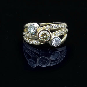 DF 1 - 14K two toned gold bypass ring with bezel set center diamonds and bead set melee diamonds.