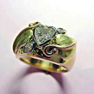 DF 3 - 14k yellow, green, rose, and white gold nature motif featuring bezel set diamonds.