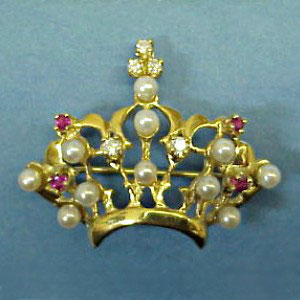 BR 5 - 14K yellow gold brooch with pearls, rubies, and diamonds.