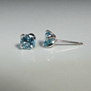 E 15 - 14K white gold earrings with blue topaz.