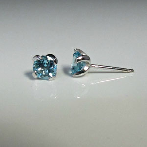 E 15 - 14K white gold earrings with blue topaz.