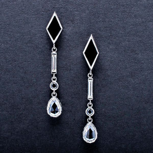 E 11 - 14K white gold drops featuring onyx, white, black and rose cut diamonds.