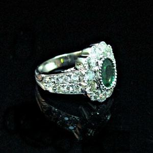 CS 35 -   14K white gold ring with pave' set diamonds and bezel set emerald.