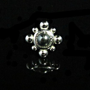 G 7 - 14k white gold tie tack with a bezel set hematite cabachon.