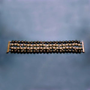BR 8 - Bracelet with black and champagne pearls, interspersed with diamonds.  Yellow gold catch with diamonds.
