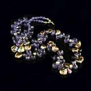 P 54 - Amethyst, pearls, and garnets accented with 14k yellow gold beads and clasp.
