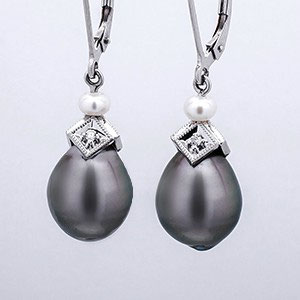 E 21 - 14K white gold earrings with black south sea pearl drops, white pearl, and diamond accents.
