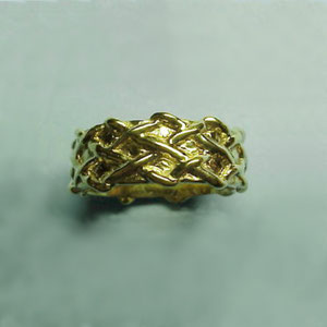B 4 - 14K yellow gold band with a woven design.