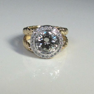 DF 5 - 14K two toned ring with bezel set center diamond and surrounded by a halo of diamonds.