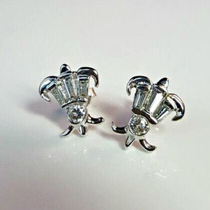 E 24 - 14K white gold Fleur-de-lis earrings with round and baguette diamonds.