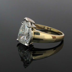 B 4 - After - The pear shaped diamond is in a new 14K two tone mounting.