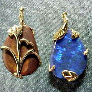 P 21 - 14K yellow gold pendant with boulder opal.
